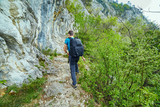 Teenager hiker on a mountain trail