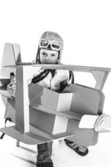 Boy and biplane.