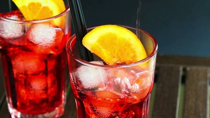 barman pouring spritz aperitif aperol cocktail and orange slices