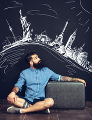 Bearded man drawing travelling