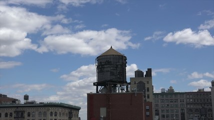 NYC cityscape with a wooden water towers at the roofs