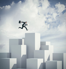 Businessman jumping on a cube. 3d rendering