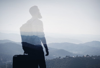 Double exposure concept with bearded man and landscape