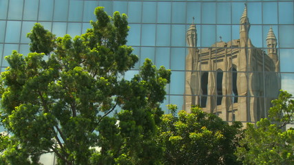 Victorian Gothic Revival cathedral reflection in glass windows.