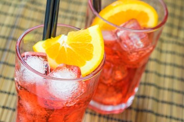 glasses of spritz aperitif aperol cocktail and orange and ice