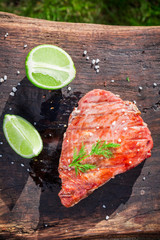 Fresh tuna with lemon and dill on grill