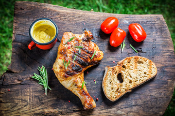 Roasted chicken leg with rosemary and pepper