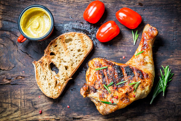 Grilled chicken leg with toast and cherry tomato