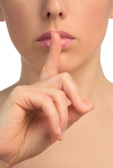 Image with woman's face shows gesture of silent