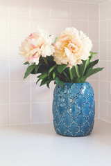 Blue moroccan vase with large white flowers