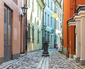 Narrow street on old city of Riga-capital of Latvia
