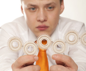 Businessman with cogwheel