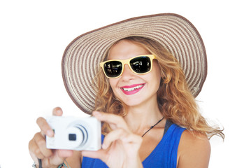 portrait of a beautiful young woman in a hat with a camera in ha