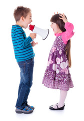 Boy shouting at girl with megaphone