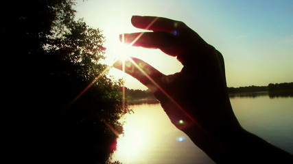 Sun in the hands, close up