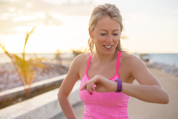 Woman checking her fitness smart watch device.