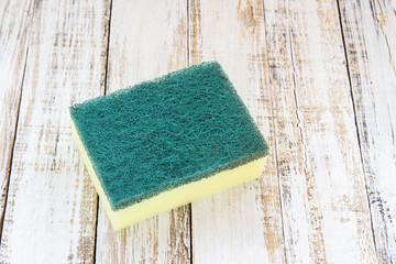 Cleaning sponges on wooden background
