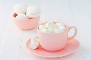 Porcelain pink crockery full of marshmallow souffle