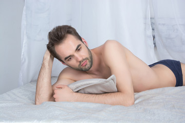A shirtless young man