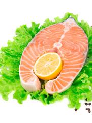 Fresh salmon steak on lettuce.
