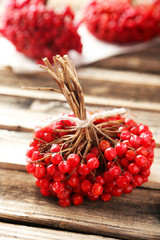 Bunch of viburnum on brown wooden background