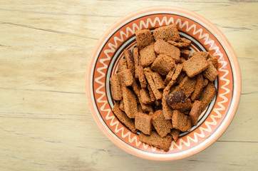 Rusks in a bowl on a wooden table