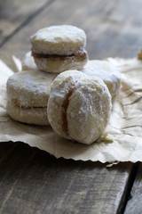 Homemade  small round cookies  on vintage wooden table