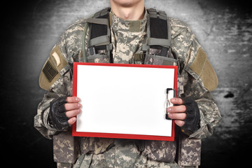 soldier holding blank clipboard