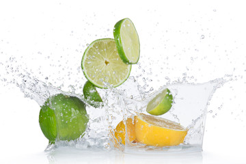 Limes and lemons with water splash