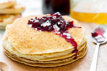 Cherry jam on a stack of pancakes Russian blini