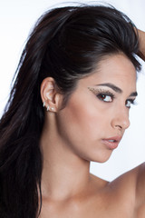 Sensual indian girl with leopard spotted makeup hands in hair