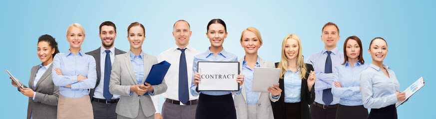 group of happy businesspeople holding contract