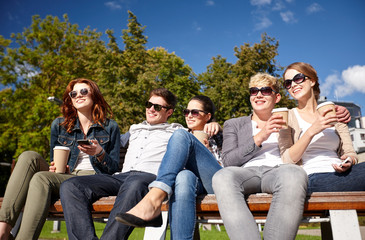 group of students or teenagers drinking coffee