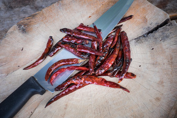 Drying the red hot chili pepper with knife  on the chopping bloc