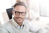 Portrait of smiling businessman with eyeglasses