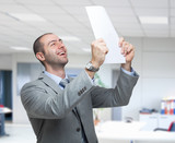 Very happy man holding a document