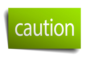 caution green paper sign on white background