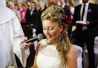 Beautiful bride at the wedding ceremony in the church