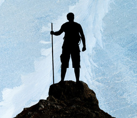 Silhouette of man on peak of mountain