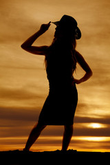 silhouette of a cowgirl touch hat look to side