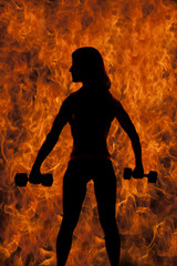 silhouette of fit woman with two weights from back