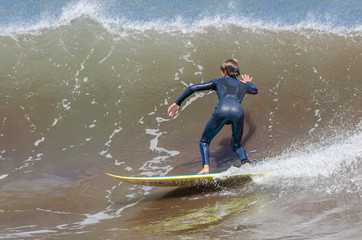 Surfing on the ocean waves.
