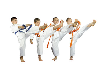 Four young athletes are beating the blow mae geri