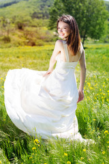 Beautiful bride girl in the yellow field
