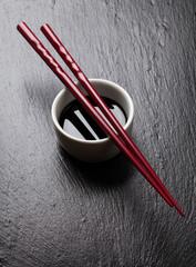Japanese sushi chopsticks over soy sauce bowl