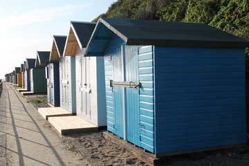 A Row of Wooden Beach Huts at the Seaside.