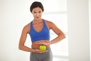 Dieting young woman standing with vitality