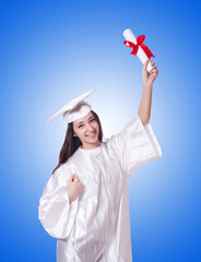 Young female student with diploma on white