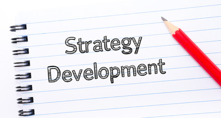 Strategy Development Text written on notebook page