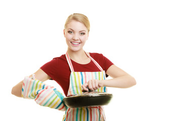 housewife or chef in kitchen apron with skillet frying pan